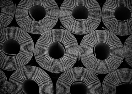 bigstock-closeup-of-rolls-of-new-black-76538120